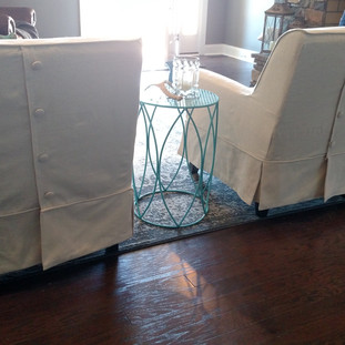 Back of slipcovered club chairs
