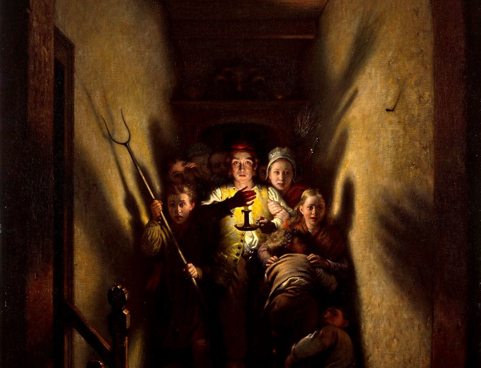 Group of scared people with a candle