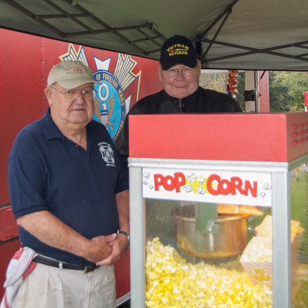 Dennis and Donnie pushing Corn