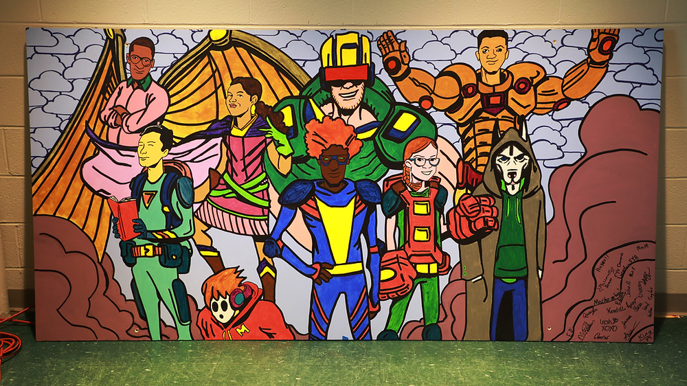 "Finished ""Turner's Titans"" murals depicting local teenagers as super heroes"
