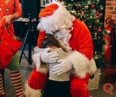 Receiving a hug as Santa.