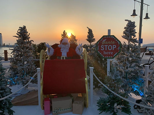 Dubai Santa appearing at La Mer's North Pole winter wonderland in Dubai. Giving gifts and a photo opportunity to families in Dubai, UAE
