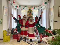 Santa with Mrs Claus and 2 naughty little elves as part of a private event in someone's villa in Dubai.