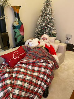 Santa asleep as part of a private event in someone's villa.