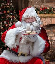 Santa enjoying a mince pie or two.