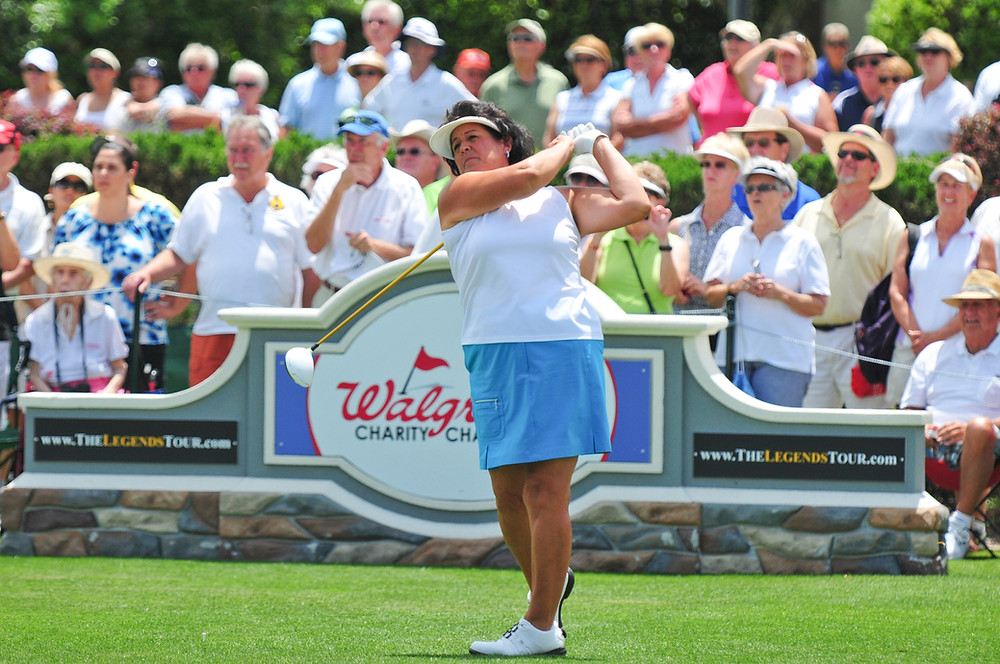 LPGA Legend Nancy Lopez tees off at the Walgreens Charity Championship at The Villages in Florida.