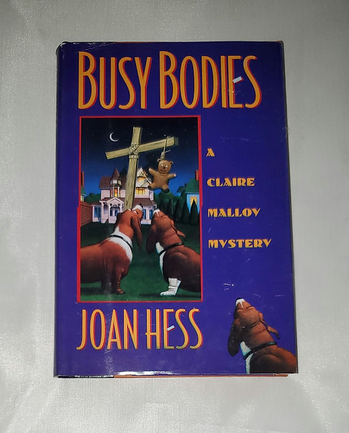 Busy Bodies: A Claire Malloy Mystery by Joan Hess
