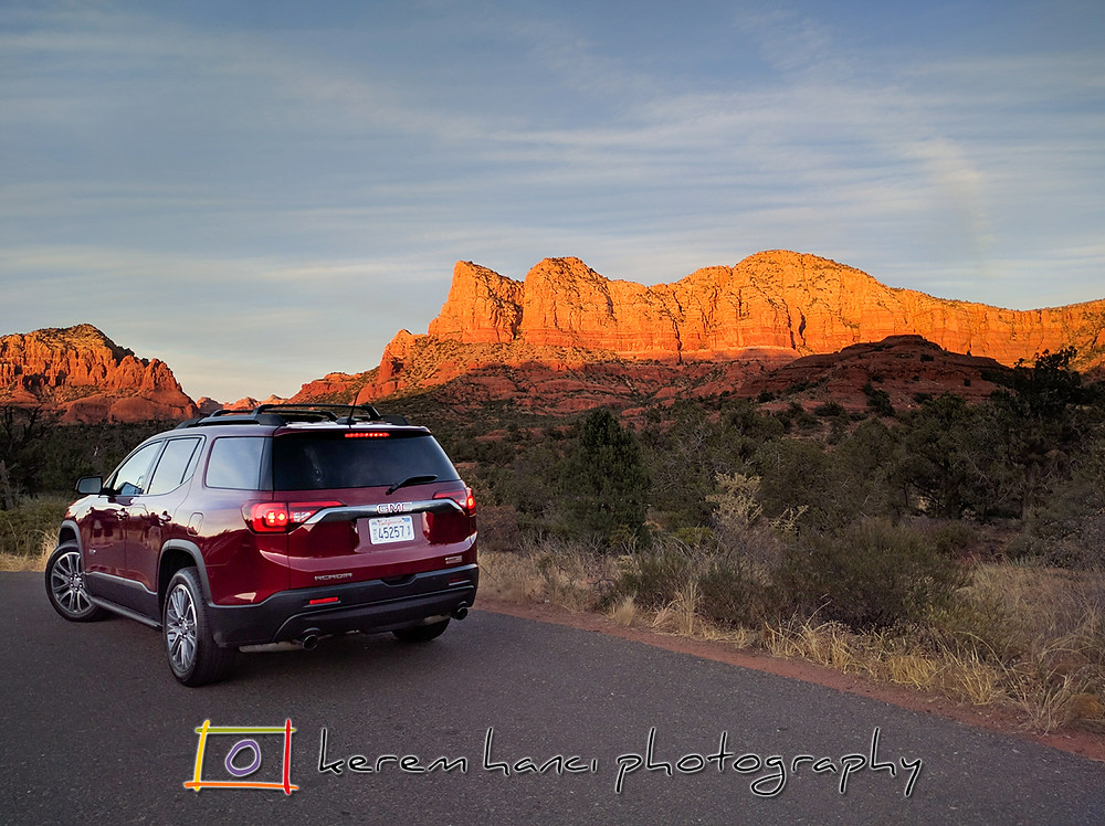 2018 GMC Acadia in front of the gorgeous colors of Sedona sunset