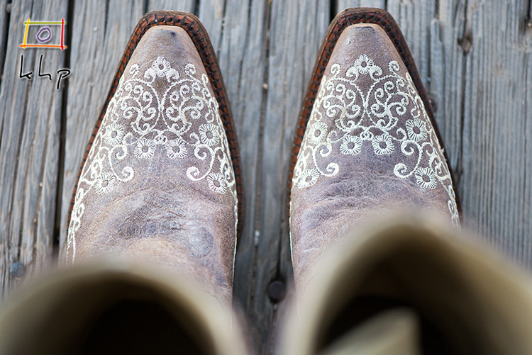 Detail of the bride's cowboy boots in Pioneertown, CA
