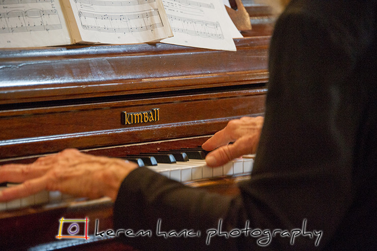 Precession music played on an esteemed Kimball piano.
