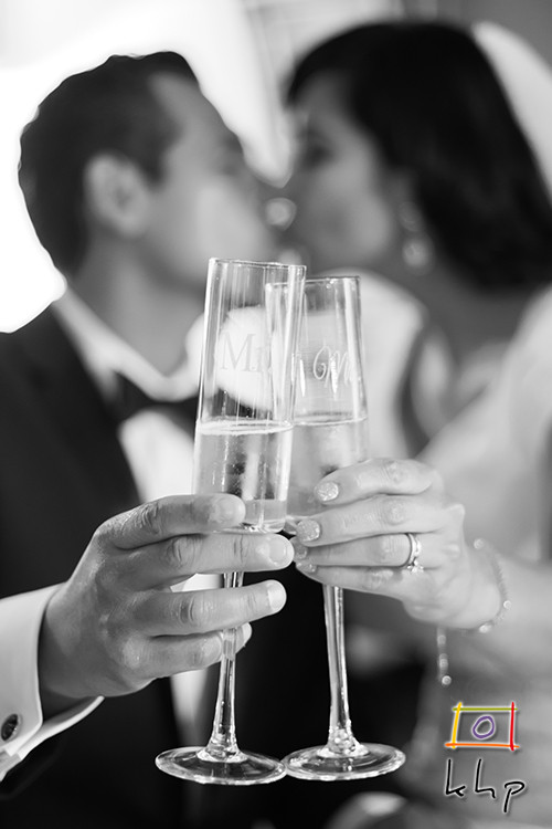 Champagne Toast as Bride and Groom kiss