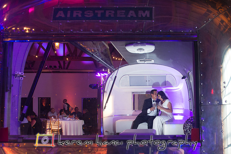 The Bride and the Groom are taking a break from the reception in the Airstream RV in the wedding venue LA River Studios