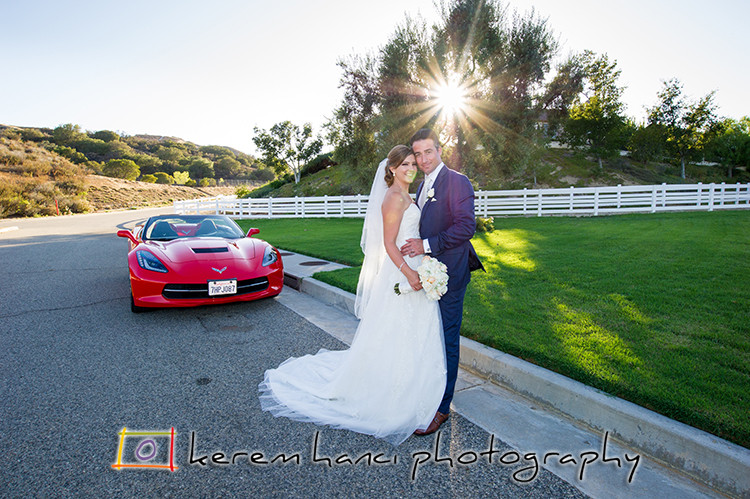 Bride and Groom Portraits in front of their Corvette with contre-jour and sun star.