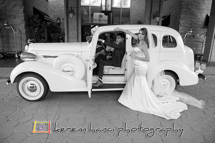 Newlyweds with the 1936 Buick 8 in front of The Hills Hotel in Laguna Hills, CA.