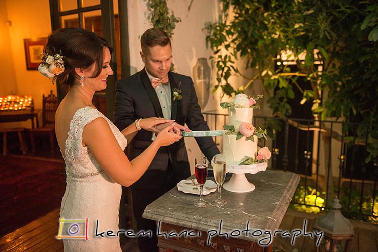 Bride and groom cutting the cake at the Villa San Juan Capistrano
