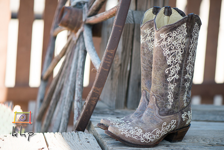 The bride's cowboy boots before the desert wedding