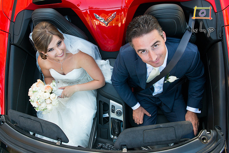 Newlyweds in their convertible Corvette