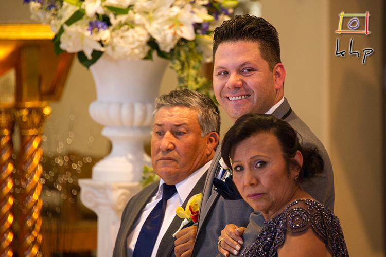 The groom can't hide his excitement before he sees his bride at the altar for the first time