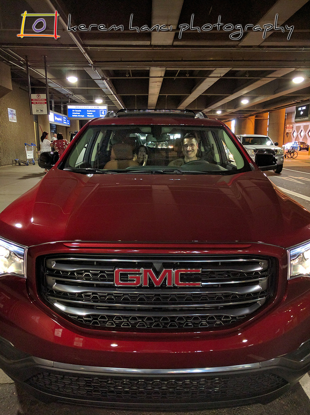 Father & Daughter smiling in a brand new 2018 GMC Acadia