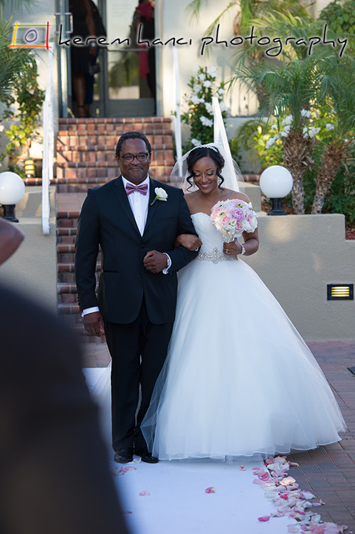 The father walks her daughter in the aisle at the Tustin Ranch Golf Club