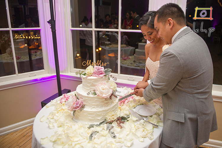 The newlywed couple cutting the cake at the Altadena Town & Country Club