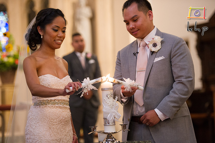 Bride and Groom lighting their Unity Candle at St. Philip The Apostle Church in Pasadena, CA