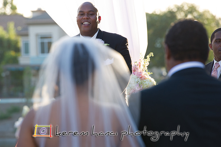 That moment when the groom's face lights up seeing his bride on the altar