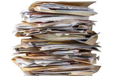 Daunting pile of real estate paperwork in selling your home | Matthew Stewart Real Estate Team