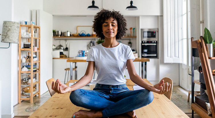 Relax when it comes to unemployment situation due to Co-Vid 19. woman meditating | Matthew Stewart Real Estate Team