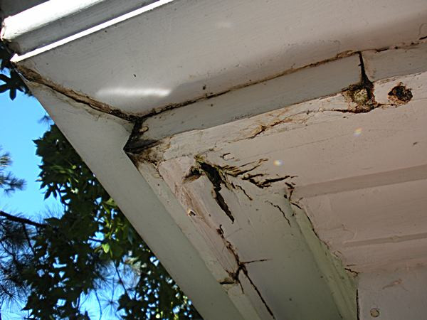 Gutters which have failed and caused wood to rot at corner of building | Matthew Stewart Real Estate Team | Roseville | Granite Bay | Rocklin