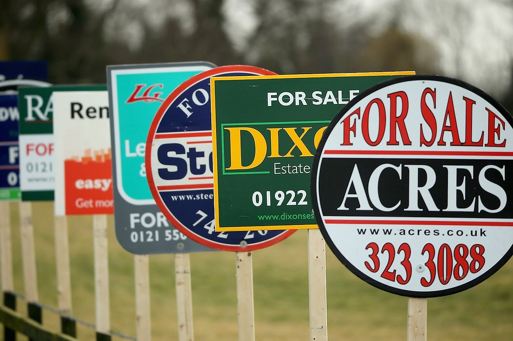 real estate signs lined up one after another.  This can be the spring selling season you want to avoid