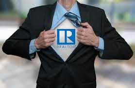 Realtor logo on real estate agent chest like Superman | Matthew Stewart Real Estate Team