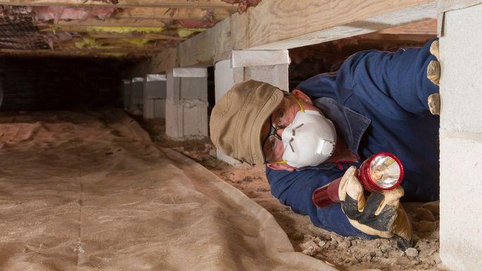 Home inspector crawling sub-floor area   Matthew Stewart Real Estate Team   Roseville   Granite Bay