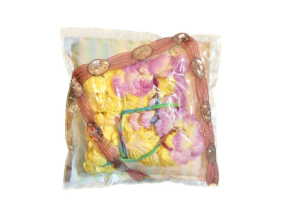 "Pillow / 14"" x 14"" / 2019 / ribbon, fake flowers, fiber fill and vinyl"
