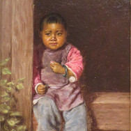 Chinese Child Sitting in Doorway