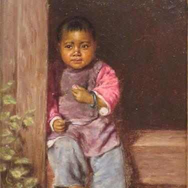 Chinese Child Sitting in Doorway