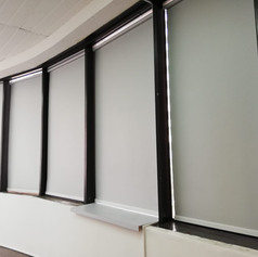 Black out roller blinds in office