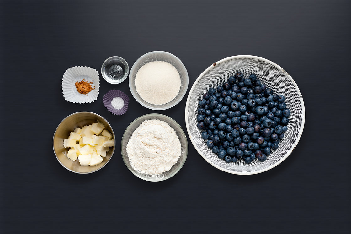 Bowls of cinnamon, water, sugar, flour, butter, salt and blueberries