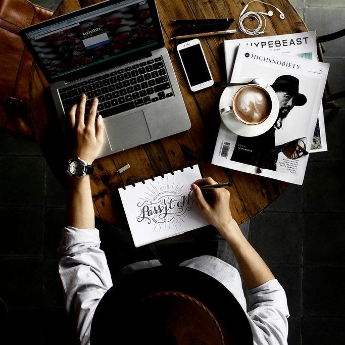 DPI Communications Why Choose Us Designer Working on Desktop