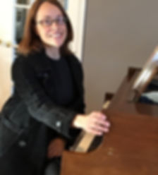 nat with piano.jpg