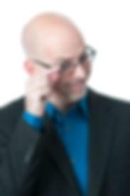 Joe Serio tilting his glasses