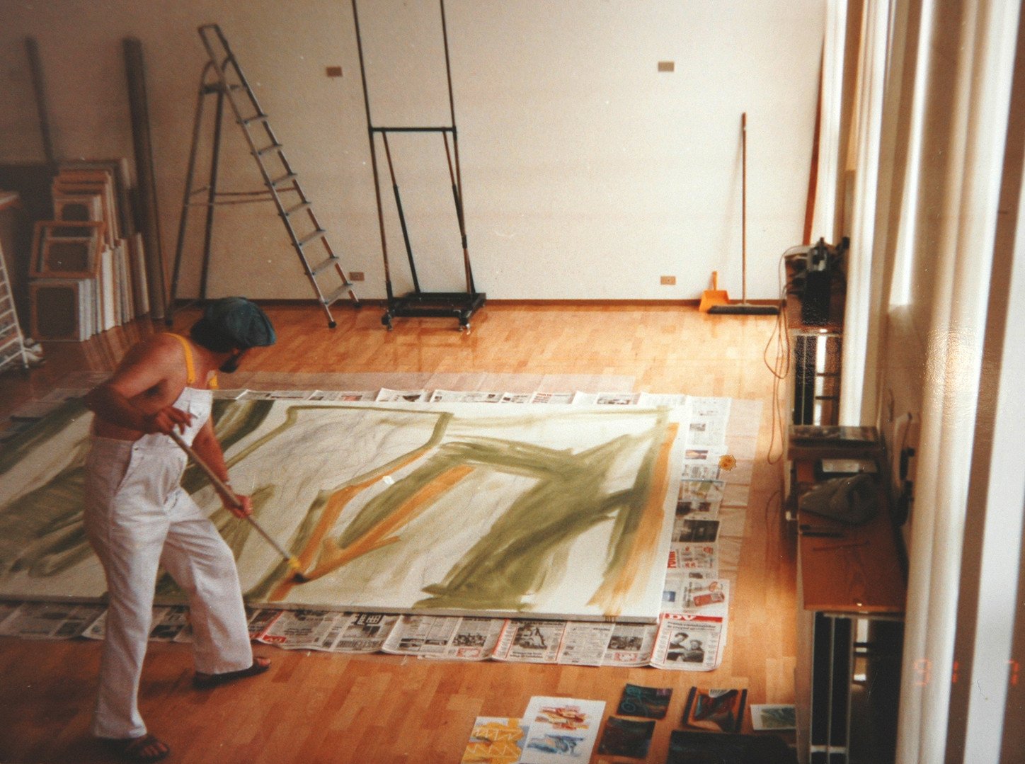 Einar working on a large canvas