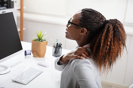 Businesswoman Suffering From Shoulder Pa