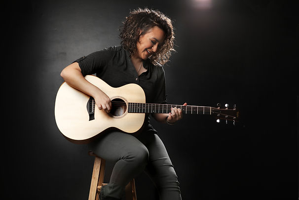 Laughin on stool w guitar copy.jpg