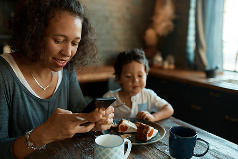 busy-young-single-mother-using-cell-phon