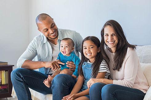 happy-multiethnic-family-sofa.jpg