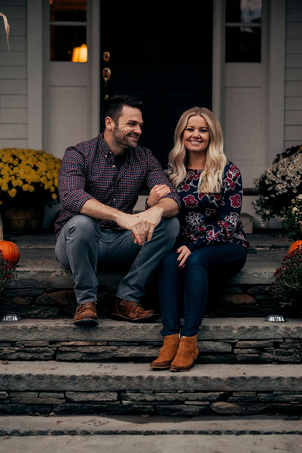 man and woman sitting on steps smiling