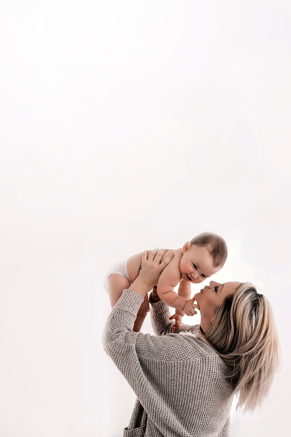 mom and baby white studio photography negative space
