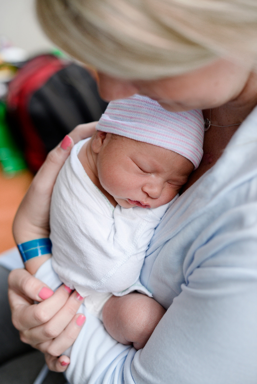 new mom holding newborn in hospital