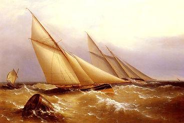 a_schooner_and_cutter_yacht_rounding_a_b